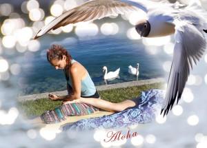 Bild einer Lomi Lomi Massage am See mit Schwaenen im Hintergrung